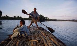 Bahir Dar, Ethiopia, Boaters drift along Lake Tana on a Papyrus reed raft