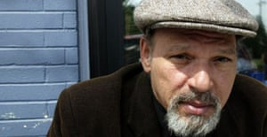 Pulitzer Prize-winning playwright August Wilson poses during a visit to a coffee shop