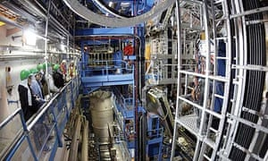 Visitors stand in front of the ATLAS detector during the LHC (Large Hadron Collider) Open Day at the European Particle Physics laboratory (CERN) in Geneva, Switzerland