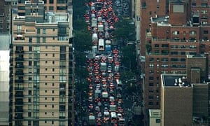Brake lights can be seen as hundreds of vehicles sit in a traffic jam on New York's Lexington Avenue