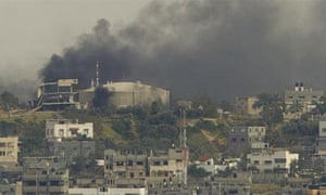 Smoke rises over Gaza City after Palestinian militants attacked an Israeli-controlled border crossing where EU-funded fuel is piped into Gaza
