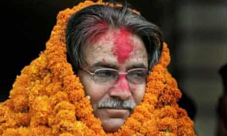 The Maoists' leader, 'Prachanda', garlanded after a landslide win in his Katmandu constituency