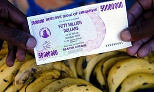 A man holds the new Zimbabwean 50 million dollar note