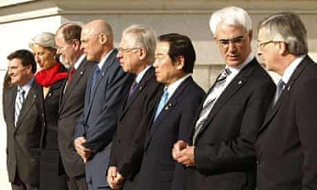 The G7 finance ministers pose for a group photo at the Treasury Department in Washington