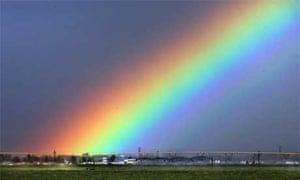 Rainbow over farmland in California
