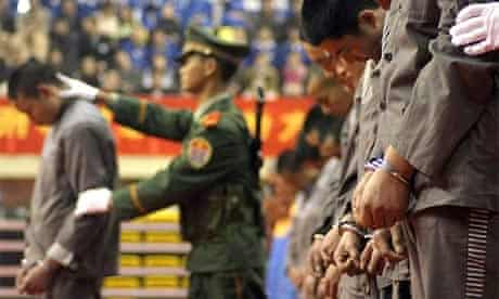 Chinese police display a group of prisoners at a sentencing rally in the east Chinese city of Wenzhou