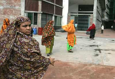Garment workers enter their factory, south of Dakha, before going on strike