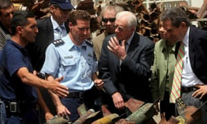 Jimmy Carter is shown the rockets that were fired on the southern Israeli town of Sderot by Palestinian militants
