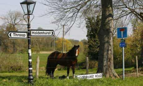 A general view of a sign pointing towards the quiet Dorset village of Holdenhurst near Bournemouth