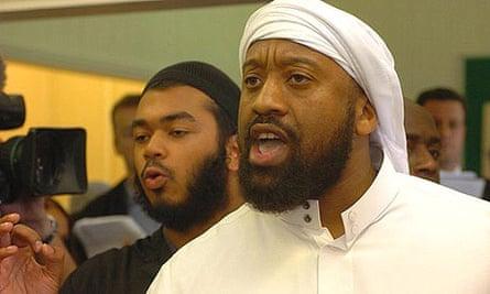 Abu Izzadeen talks to the media after interrupting the speech of home secretary John Reid in August 2006.
