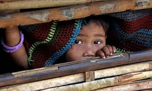 A Bhutanese refugee looks from a bamboo hut in the Ti Mai camp, Nepal
