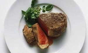 Fried beef steak on a plate.