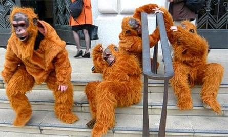 Greenpeace protesters dressed as orangutans demonstrate outside Unilever's central London headquarters