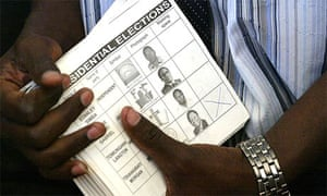 A Zimbabwe polling agent holds voting papers during a recount