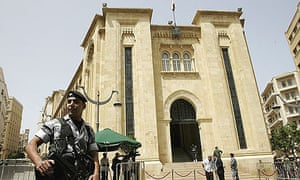 A police officer stand guards in front the Lebanese parliament building in Beirut.