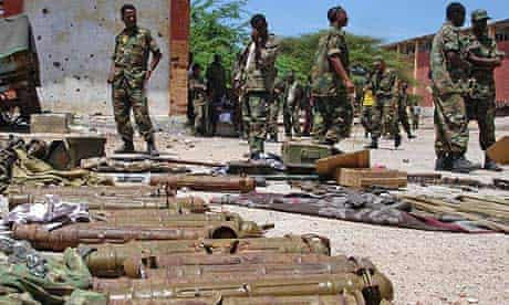 Ethiopian soldiers in Mogadishu, Somalia, guard a cache of ammunitions they said were used by insurgents during two days of heavy fighting