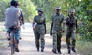 Rebel Tamil Tigers patrol the Tamil-controlled village of Uthayanagar East, near Kilinochchi, Sri Lanka