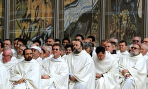 Capuchin monks attend an open mass to mark the anniversary of Padre Pio's death and the display of his body