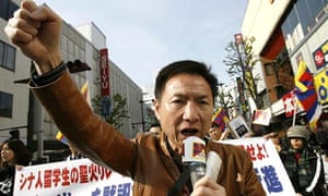 A pro-Tibet protester clenches his fist during a rally in Nagano, central Japan
