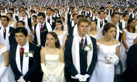 Some 3,600 couples attend a Unification Church ceremony at a gymnasium in Seoul