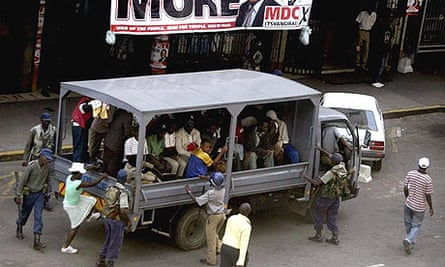Supporters of Zimbabwe's Movement for Democratic Change (MDC) party are detained by police, outside its headquarters in Harare.