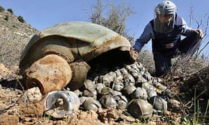 A Mines Advisory Group (MAG) inspector looks at a Cluster Bomb Unit in the village of Ouazaiyeh, Lebanon