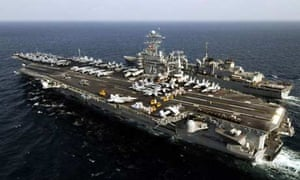A US aircraft carrier in Gulf waters. Photograph: Kenneth R Hendrix/AFP/Getty Images