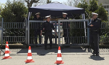 Police at the entrance to the Fritzl family home in Amstetten, Austria.