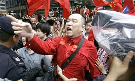 A China supporter argues with pro-democracy protesters at the Olympic torch relay in Hong Kong