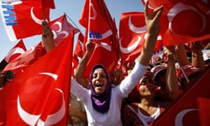 Supporters wave flags for Devlet Bahceli in Istanbul, Turkey
