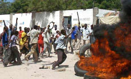 Somalis burn tyres and throw stones during a demonstration over inflation and food prices in Mogadishu