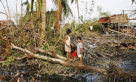 Children standing amid the debris of their village, which was destroyed by the cyclone, near the township of Kunyangon, Burma