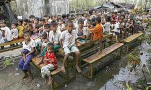 Children congregate outside a school near Kundangon, Burma