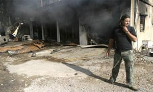 A man surveys the remnants of a burnt shop after today's clashes in Shweifat, south-east of Beirut