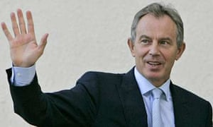 Tony Blair arrives for a meeting at the headquarters of the Palestinian president, Mahmoud Abbas