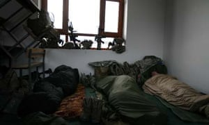 US soldiers from Charlie Company begin to wake after sleeping in a school in Rabat, a rare night spend indoors. Photograph: John D McHugh