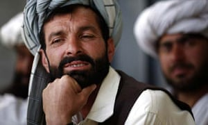 An Afghan man listens to US soldiers from the Civil Affairs team at FOB Boris. Photograph: John D McHugh
