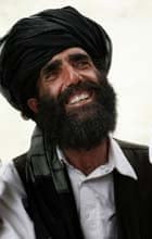 An Afghan man smiles as he listens to US soldiers from the Civil Affairs team at FOB Boris. Photograph: John D McHugh