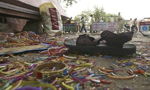 Broken bracelets and a sandal litter the ground at the scene of one of seven bomb blasts to hit the Indian city of Jaipur