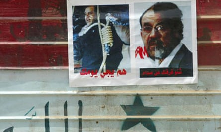 Images of Iraqi prime minister Nouri al-Maliki with a noose around his neck and half his face metamorphosing into Saddam Hussein in Sadr City