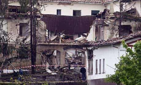 Officers at the scene of the bomb blast in Legutiano, Spain