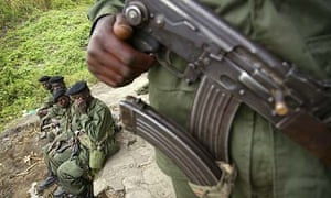A fighter loyal to Congolese general Laurent Nkunda holds his weapon in the town of Sake, eastern Democratic Republic of Congo
