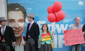 Labour supporters dressed as 'Tory Toffs' stand outside the office of Conservative candidate Edward Timpson in Crewe, Cheshire