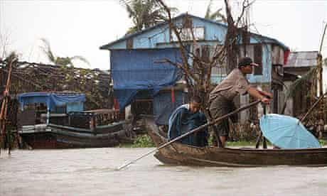 Cyclone victims row their boat in the town of Bogale, in the Ayeyarwady delta, Burma.