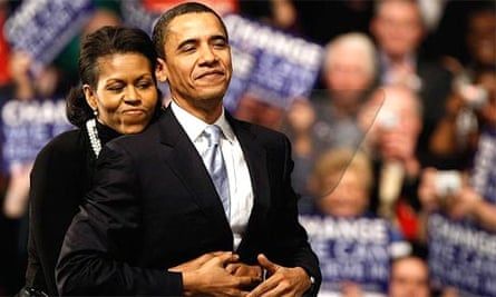 Barack Obama is hugged by his wife, Michelle Obama, before a speech at a primary night rally in Nashua, New Hampshire