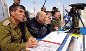 The Israeli prime minister, Ehud Olmert, with the Israeli defence forces chief of staff, Gadi Ashkenazi, at a watch post in the Golan Heights, an area of dispute between Syria and Israel.