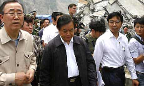 The UN secretary general, Ban Ki-moon (left) and officials walk past the ruins of a collapsed school in Sichuan province. Photograph: Nicky Loh/Getty