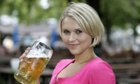 A German girl holding a stein of beer