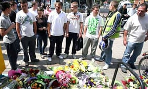 People lay flowers at the scene of the fatal stabbing in Sidcup, Kent. Photograph: Lewis Whyld/PA