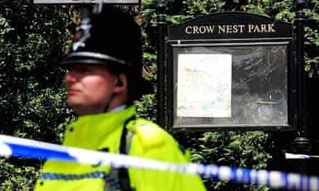 A police officer stands guard at Crow Nest Park, Dewsbury, where a teenager was found dead